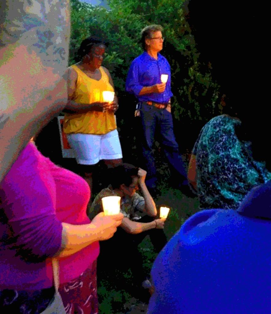 (Clockwise) Tina Degree, Rev. Lovett, and Marisa look on.