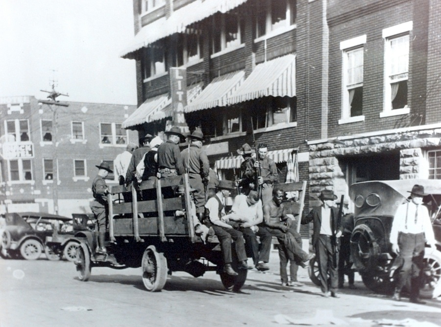 Caption: Blacks being taken to the Brady Theater during the 1921 Tulsa Race Riot near Greenwood. (photo courtesy Greenwood Cultural  Center)  Photographer: Kelly Kerr  Title: staff photographer  Credit: Tulsa World  City: Tulsa  State: OK  Country: USA  Date: 19970620  CaptionWriter: KK  Category: NEW  Source: Tulsa World